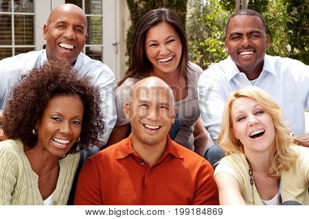 Multicultural group of friends talking and laughing.