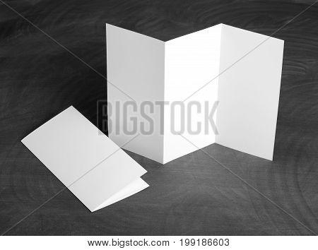 Identity design corporate templates company style set of booklets blank white folding paper flyer on a black chalkboard