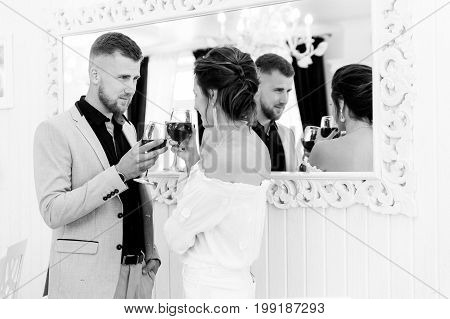 young couple flirting in the restaurant on a date.first date, love, black and white photo
