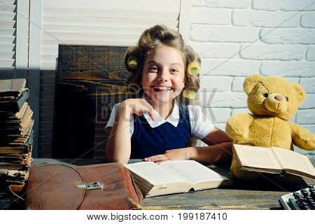 Little Baby Secretary In Cabinet With Bear.
