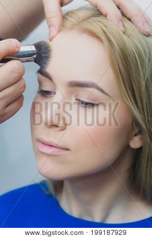 Girl Getting Makeup On Face With Powder Brush
