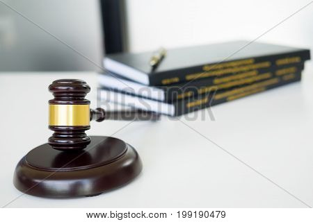 gavel Judge hammer with legal book on brown wooden desk with copy space. Legislation Concept