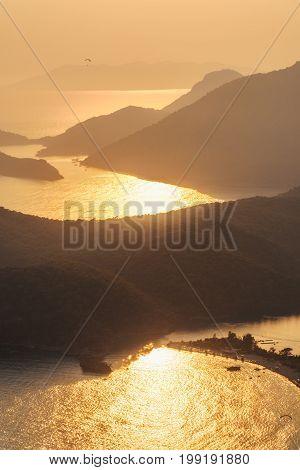 Beautiful Seascape With Silhouettes Of Mountain Ridges