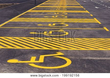 Parking Lot With Painted Yellow Sign Of Wheelchair 2
