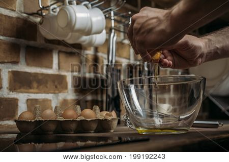 Partial View Of Young Man Preparing Omelette For Breakfast In Kitchen At Home