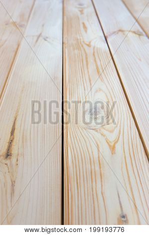 Vertical photo of a new light wooden texture floor. Close-up