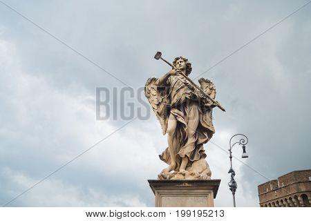 marble statue of an angel on a tiber bridge