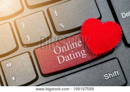 concepts of online dating with message on enter key of keyboard.