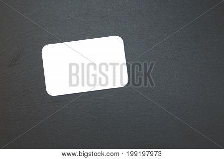 Blackboard of slate with blank writable notepad