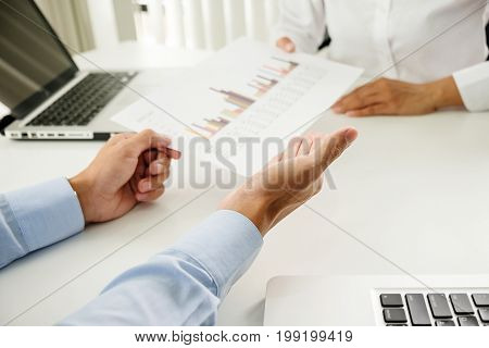 Business Concept. Business People Discussing The Charts And Graphs Showing The Results Of Their Succ
