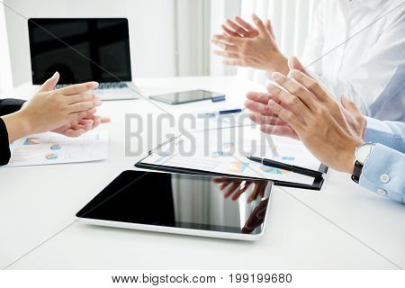 Business Seminar Listeners Clapping Hands With Documents Having Discussion In Office