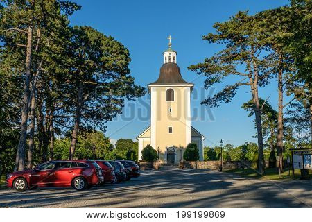 LOTTORP, SWEDEN - JULY 13, 2017: Hogby church on in Lottorp. The church was rebuilt 1870-1871 but the oldest parts date back to the 12th century.