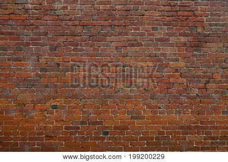 Rundown red brick wall Rundown old red brick wall from a Georgian walled garden
