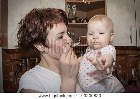 Mother Feeds The Baby Baby Puree