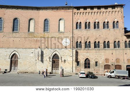 Siena Italy - 7 July 2017: Salimbeni palace on Duomo square at Siena in Italy