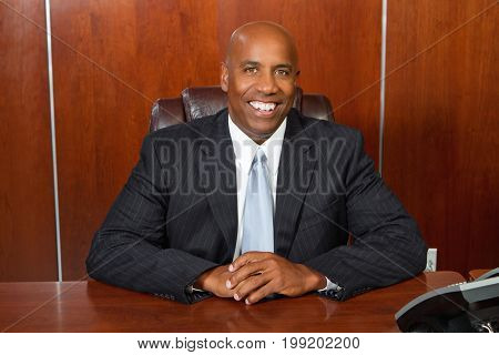 Confident African American businessman working on his computer.