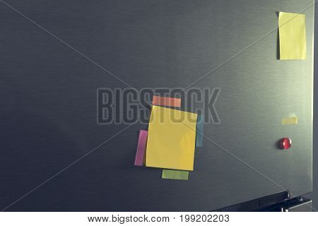 Empty Note Paper And Magnet Attached On Refrigerator Door For Display Message.