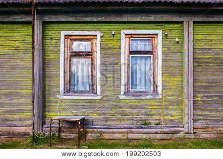 old green village russian house with two windows texture or background
