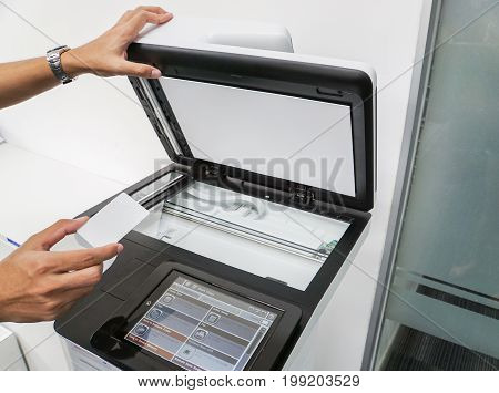 close up businessman hold smart card for scanning and printing documents