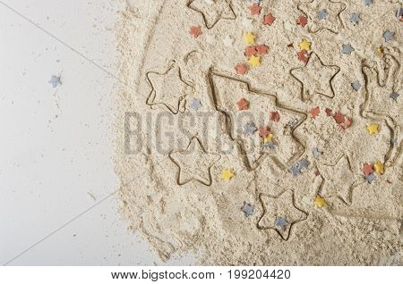 Abstract Christmas food background with cookies molds and flour