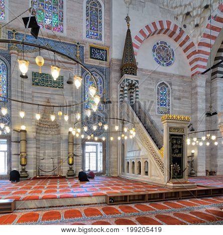 Istanbul Turkey - April 19 2017: Marble floral golden ornate minbar (Platform) and niche with few prayers at Suleymaniye Mosque Istanbul Turkey