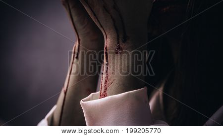 Closeup Zombie arm women death ghost with blood darkness background horror halloween festival concept