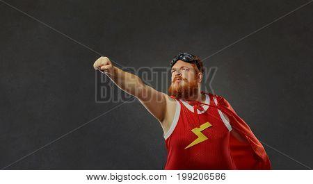 Fat funny man in a superhero costume.Concept success.