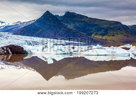 The concept of northern extreme tourism. The largest glacier in Iceland - Vatnajokull  in the summer sunset. Glacier provides water Jokulsarlon Ice Lagoon