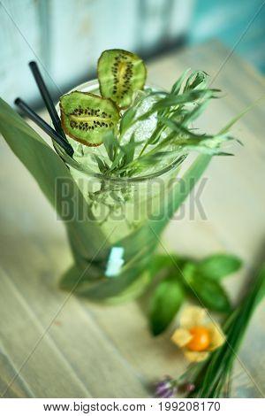 Homemade lemonade from fresh tarthun with lime in glass glasses, selective focus