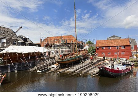 Historic shipyard with wooden fishing boats in the harbor of the village Spakenburg in the Netherlands.