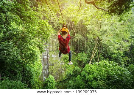 Freedom adult Man Tourist Wearing Casual Clothing On Zip Line Or Canopy Experience In Laos Rain Forest