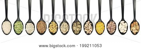 Variety of raw legumes and rices in spoons on white background