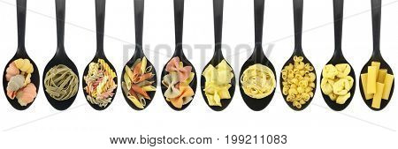 Variety of raw pasta in spoons - white background