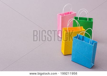 Color packets for purchases on a gray background. Copy space for text