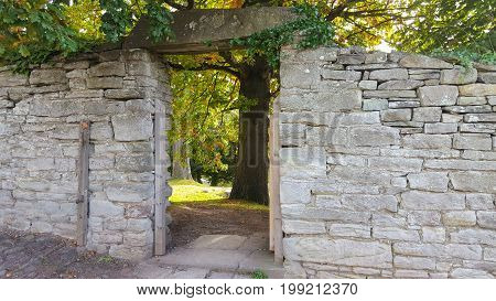 Ancient Stone Wall and portal in a garden