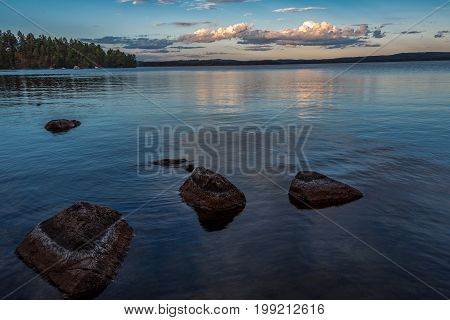 Beautiful view over lake un sunset with colorful clouds in the sky