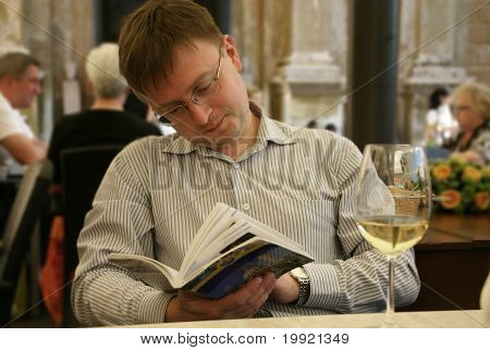 Young  Man Reading Guidebook