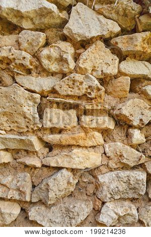 A fragment of old ruined stone wall
