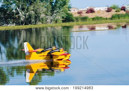 A floating Radio controlled model hydroplane speeds up to take off on Guadiana river Badajoz