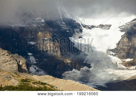 athabasca glacier with clouds west canada british columbia