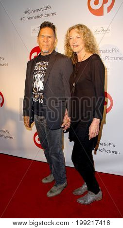 A. Martinez and wife Leslie attend the