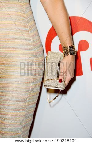 Vanessa Cater with a fashionable clutch purse at the