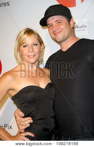 Gigi Edgley and guest attend the