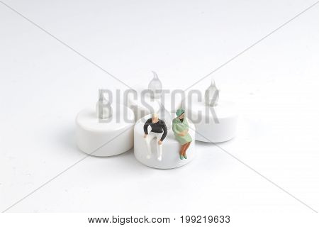 Tiny Of Figure Sit On The Candle