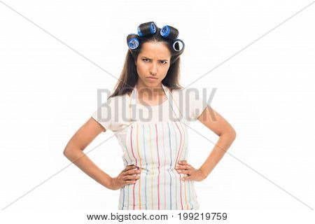 'angry Housewife With Curlers Standing With Hands On Hips, Isolated On White