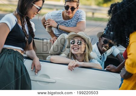 multiethnic group of happy friends having conversation together