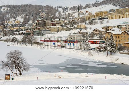 ST. MORITZ, SWITZERLAND - MARCH 06, 2009: View to the railway station and buildings of St. Moritz, Switzerland. St.Moritz is the famous ski resort in Switzerland.