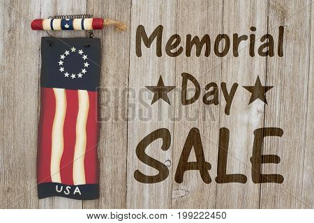 Memorial Day sale message USA patriotic old flag on a weathered wood background with text Memorial Day Sale