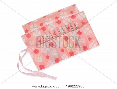 Numbers of crochet hooks in lovely cloth case isolated on white background