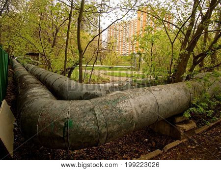 large diameter pipe with hot water above the earth, Moscow